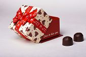 picture of valentine candy  - Opened gift box with red ribbon and sweets candy. 8 March, Mothers Day, Womens day, or Valentines Day. ** Note: Shallow depth of field - JPG