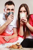 Young Funny Couple Drinking Tea Or Coffee