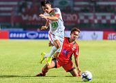 Sisaket Thailand-february 18: Anucha Suksai (orange) Of Sisaket Fc. In Action During Thai Premier Le