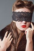 Woman With A Lace Blindfold.