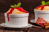 stock photo of vanilla  - Vanilla souffle or cupcake dessert with strawberry cream  - JPG
