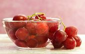 Red Grapes Inside Fresh Water