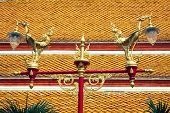 stock photo of lamp post  - Thai traditional beautiful golden swan on street lamp post in Bangkok Thailand - JPG