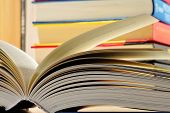 foto of hardcover book  - Composition with hardcover books in the library - JPG