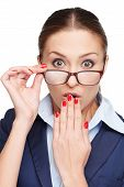Young surprised business woman with glasses