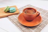 Colorful macarons with coffee