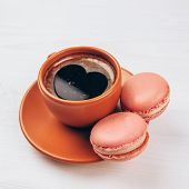 Colorful macaroons with coffee
