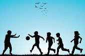 Children Silhouettes Playing Football