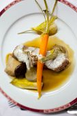 stock photo of veal  - Peace of veal carrots and artichoke on a plate - JPG