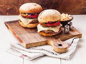 image of burger  - Burger with meat and coleslaw on wooden background - JPG
