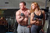 Coach client in gym