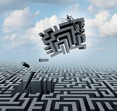 picture of solution  - New thinking and empowerment concept as a businessman riding a chunk of a maze or labyrinth as a business or life success concept and solution symbol for finding the answer - JPG