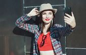 Beautiful Young Hipster Girl In The Hat Taking Picture Of Herself, Selfie