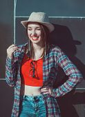 Young Beautiful Hipster Girl In The Hat Laughing