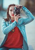 Hipster Girl Making Picture With Retro Camera. Focus On Camera