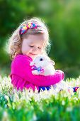 stock photo of petting  - Adorable little girl - JPG