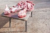 pic of slaughter  - Pieces of pig over wooden table - JPG