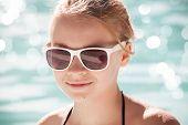 Little Blond Girl In Sunglasses, Closeup Portrait