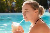 Little Blond Girl Drinks Cocktail Through Plastic Tube