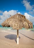 Wooden Umbrella On The Beach In Dominican Republic
