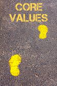 Yellow Footsteps On Sidewalk Towards Core Values Message