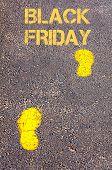 Yellow Footsteps On Sidewalk Towards Black Friday Message