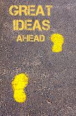 Yellow Footsteps On Sidewalk Towards Great Ideas Ahead Message
