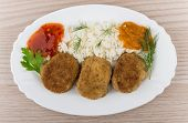 Постер, плакат: Fried Cutlet With Rice Squash Caviar Ketchup And Greens