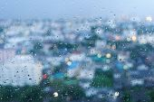 picture of raindrops  - raindrop on glass and bright bokeh in background - JPG