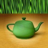 stock photo of teapot  - Green teapot on a bamboo mat - JPG