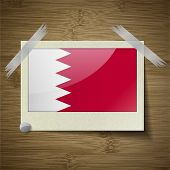 picture of bahrain  - Flags of Bahrain at frame on wooden texture - JPG