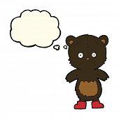 stock photo of bear cub  - cartoon black bear cub with thought bubble - JPG