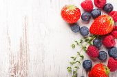 picture of berries  - Berries on White Wooden Background - JPG