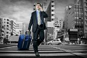 foto of crossroads  - Man with baggage speaking by phone on the crossroad  - JPG