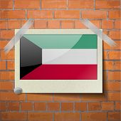 stock photo of kuwait  - Flags of Kuwait scotch taped to a red brick wall - JPG