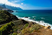 picture of atlantic ocean  - Road to coast of Atlantic ocean beach with mountains or rocks and blue sky with clouds and skyline or horizon in Tenerife Canary island Spain at spring or summer - JPG