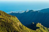 foto of atlantic ocean  - Coast of Atlantic ocean with green mountain or rock and sky with skyline in Tenerife Canary island Spain at spring or summer - JPG