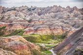 pic of mud  - The Yellow Mounds area of the Badlands is characterized by the yellow and red colors of the weathered and eroded mud of the ancient sea floor - JPG