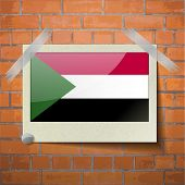 stock photo of sudan  - Flags of Sudan scotch taped to a red brick wall - JPG