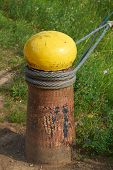 picture of bollard  - Big Old Ship bollard with steel cables from a ship on the shore - JPG