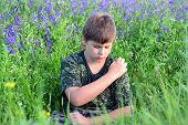 image of excrement  - A teen boy with allergies in flowering herbs - JPG