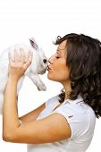 stock photo of hand kiss  - Young woman kissing a rabbit in her hands isolated on white background - JPG