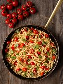 foto of cooked crab  - close up of rustic spicy italian crab and cherry tomato spaghetti pasta - JPG