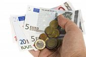 Euro And Coins In Hand