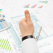 picture of cpa  - Thumb up over 1040 Tax Form  - JPG