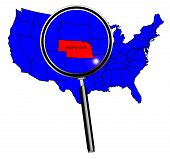 picture of nebraska  - Nebraska state outline set into a map of The United States of America under a magnifying glass - JPG