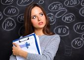 picture of yes  - Thinking young woman with yes or no choice on gray background - JPG