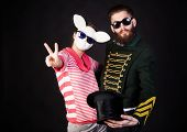 foto of queer  - Magician with his assistant in white rabbit mask - JPG