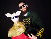 picture of queer  - Magician with his assistant in white rabbit mask - JPG