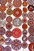 picture of pottery  - Pottery stall display of colourful hand crafted ceramic plates - JPG